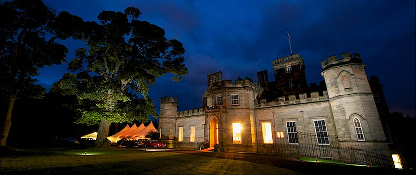Photo of the Ritz Trio at Winton Castle by night